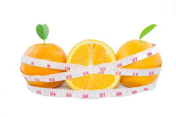 Fresh Oranges fruit with measuring tape on white background