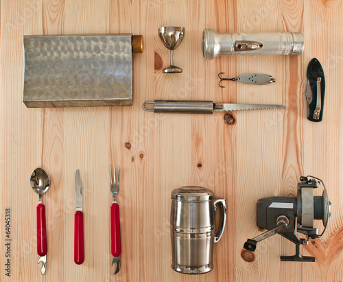 travel kit traveler scout  on a wooden background
