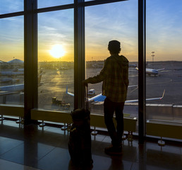Silhouette of man near window in airport