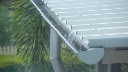 Rain pouring onto a corrugated aluminium roof