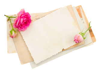 bunch of old papers with roses