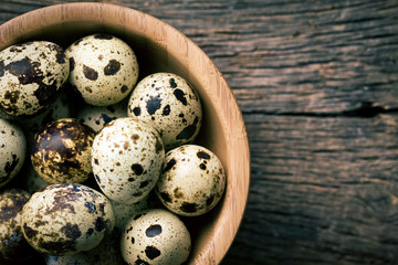 top view of quail eggs in bowl