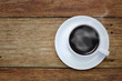 cup of coffee on the wooden table background