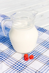 Milk in jug and raspberry