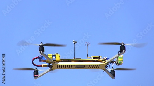 Copter\drone  fly  against the blue sky