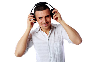 Happy man with headphones over white background