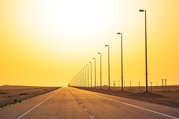 Empty road in the desert at sunset, United Arab Emirates