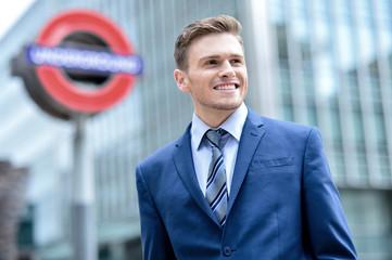 Businessman standing outside modern building