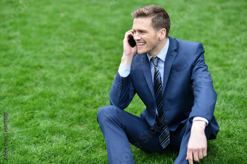 Businessman using mobile phone in park