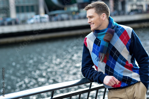 Stylish young man watching the river