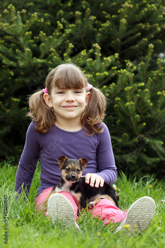happy little girl with cute puppy pet