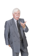 Old man in suit and gray hair with open hand