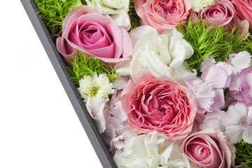 Partial view of a box filled with flowers