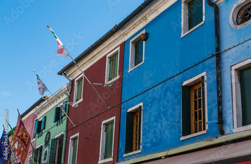 Flags on Colorful Burano Buildings