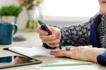 Elderly woman with mobile phone