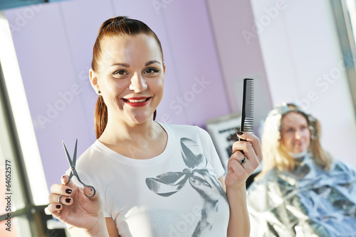 Portrait of happy female hairdresser