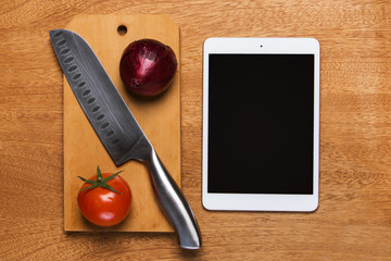Kitchen. Knife with tablet