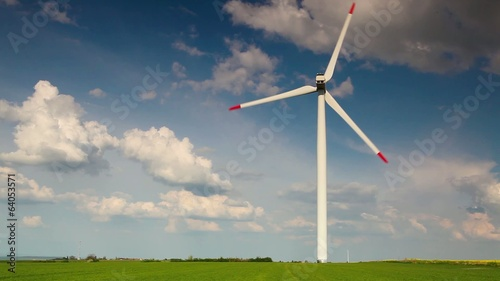 Wind turbine on a spring field at sunset