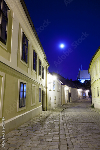 deserted street of the old European city in a full moon
