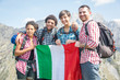 People with Italian Flag on top of Mountain