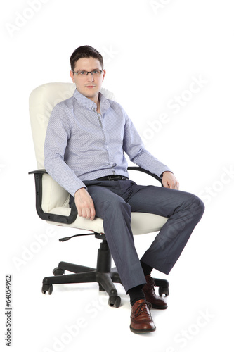a young man sitting on a chair isolated on white
