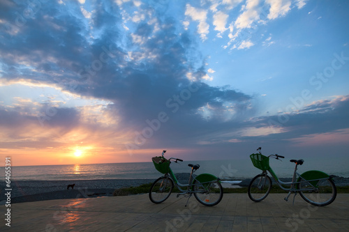 Two bicycles at sunset
