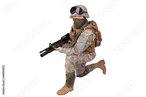 US soldier with assault rifle on white background