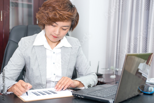 Business woman write