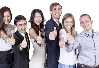 "friendly team of young professionals shows gesture ""thumbs up"""