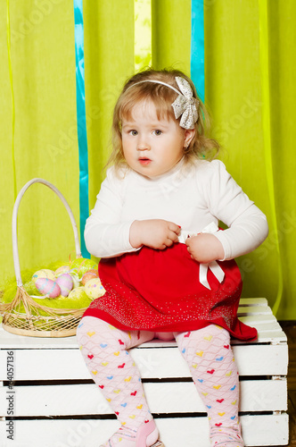 little girl in a beautiful dress with a barrette