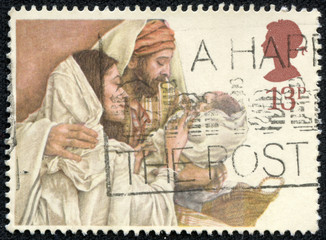 Christmas postage stamp with Mary, Joseph and Baby Jesus