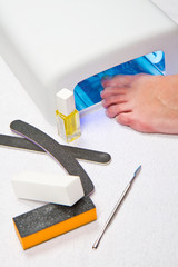 Feet with uv lamp for nails