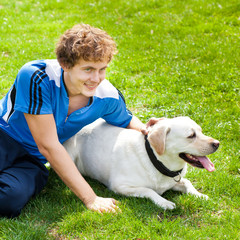 curl smiling Man with his dog lying outside