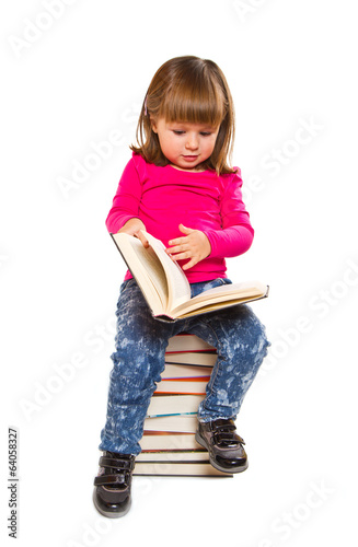 beautiful little girl with big stack of books