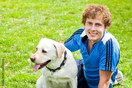 curl smiling Man with his dog siting outside