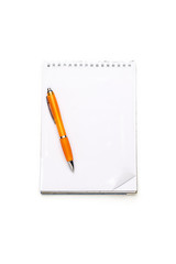 open blank note pad with ring binder and ball pen, isolated on w