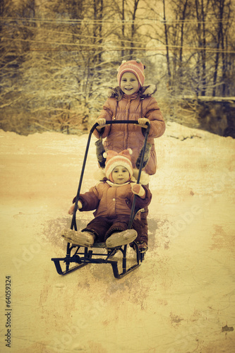 Kids skating and sledding in a grunge style.