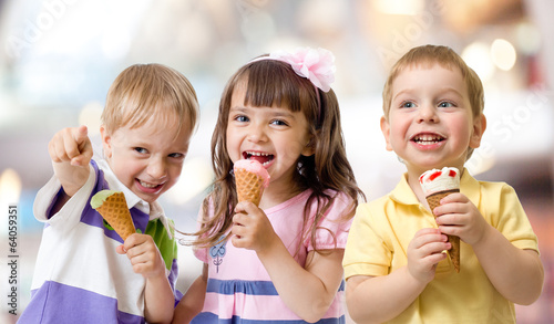 funny children group kidding with ice cream on party - 64059351