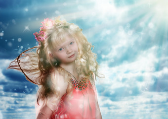 Fairy girl on a background of the sky .