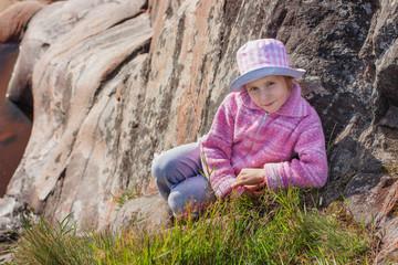 Happy girl on a rock.