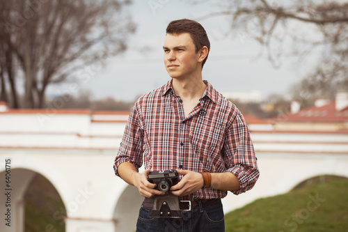 hipster guy in the street with old camera