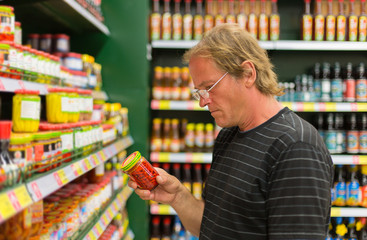 man buys hot peppers in the supermarket