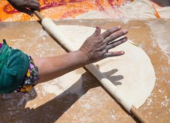 orient woman baking bread