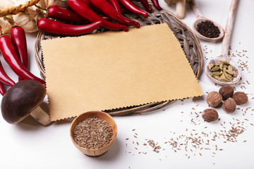 Different spices and blank paper, isolated on white