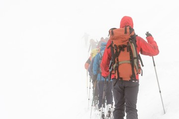 Skiers lost in the fog