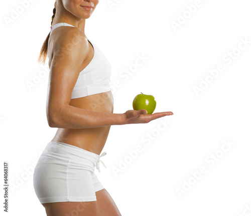 young attractive sporty woman with green apple