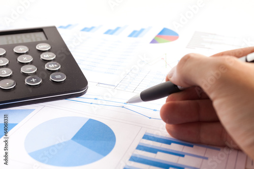 Business person examining a report