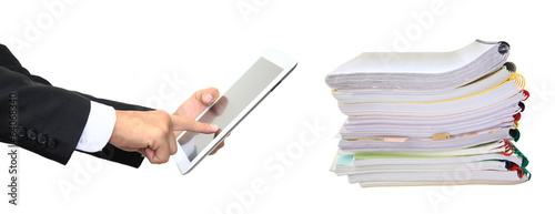 Stack paper folders and finger pointing to tablet isolated