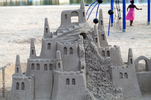 A beautiful sand castle on a beach.