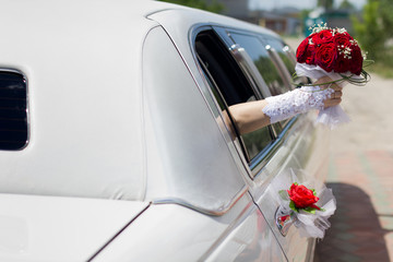 Bridal bouquet in a car window